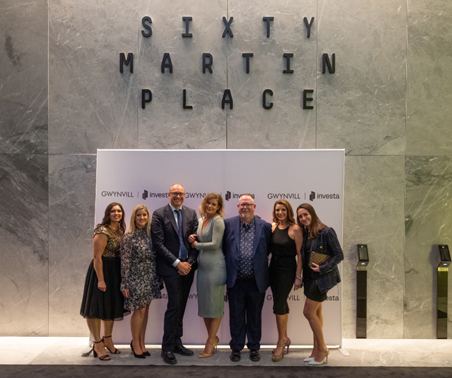 sixty martin place team in front of media wall